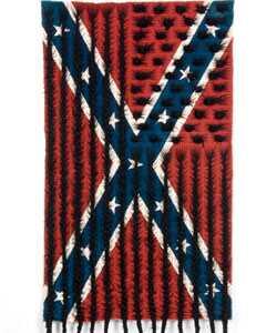 Vlasy umenie: umelca Texas vytvára čierne vlasy konfederačné vlajky